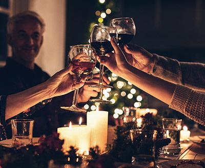 Family holding wine glasses